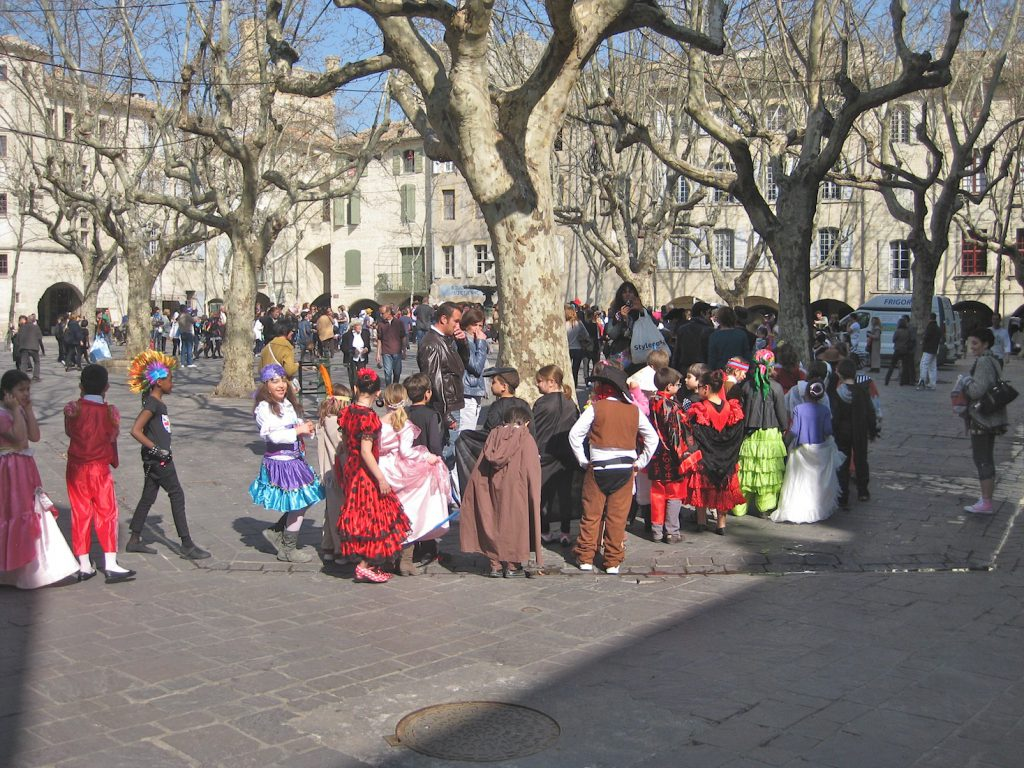 Children in a carnival in Place aux Herbes Uzes