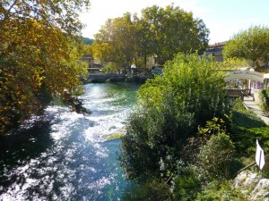 The rushing waters of the River Sorgue in Fontaine de Vaucluse, Provence, France