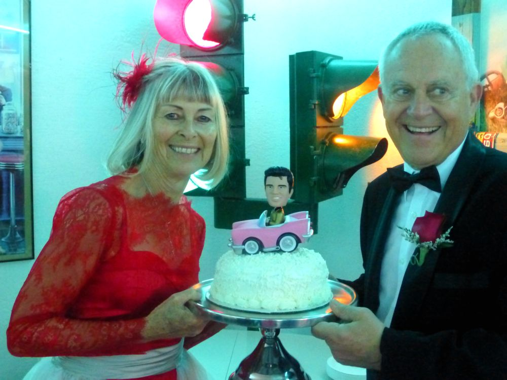 Bride & Groom with their cake