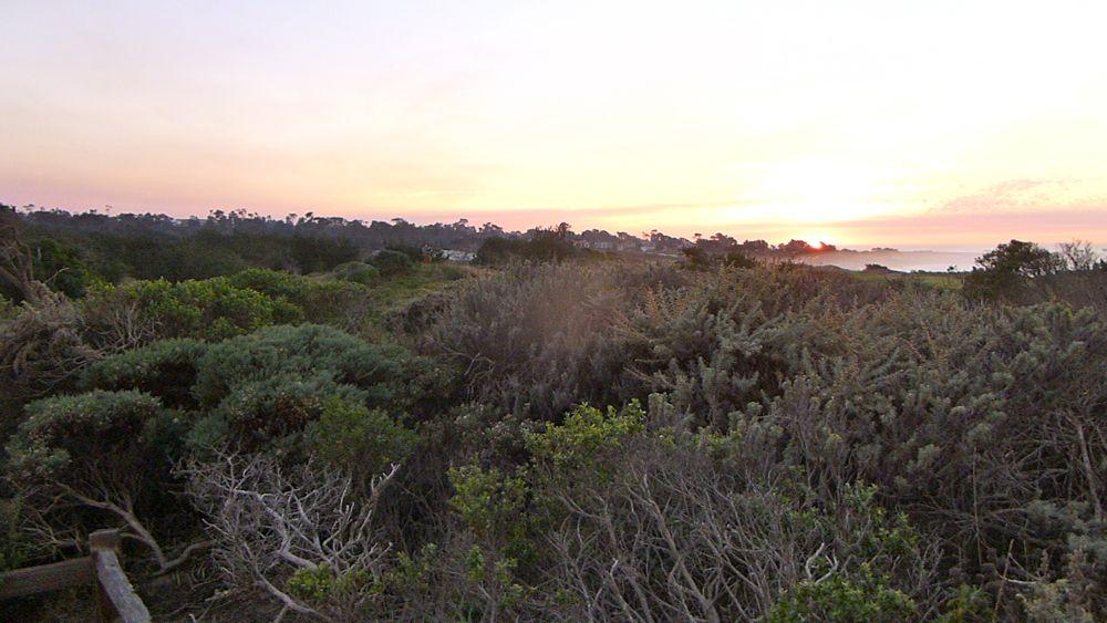 As sun sets at Spanish Bay, 17 Mile Drive, Carmel, California, USA