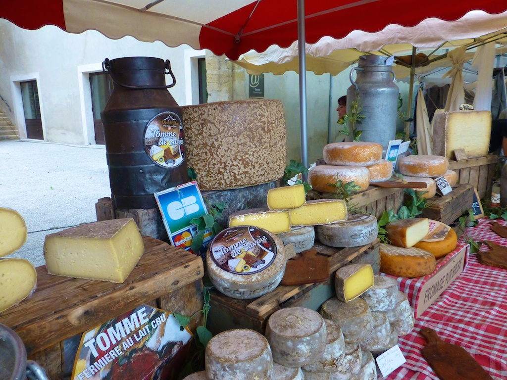 Cheeses for sale in the Lourmarin market, Luberon, Provence, France