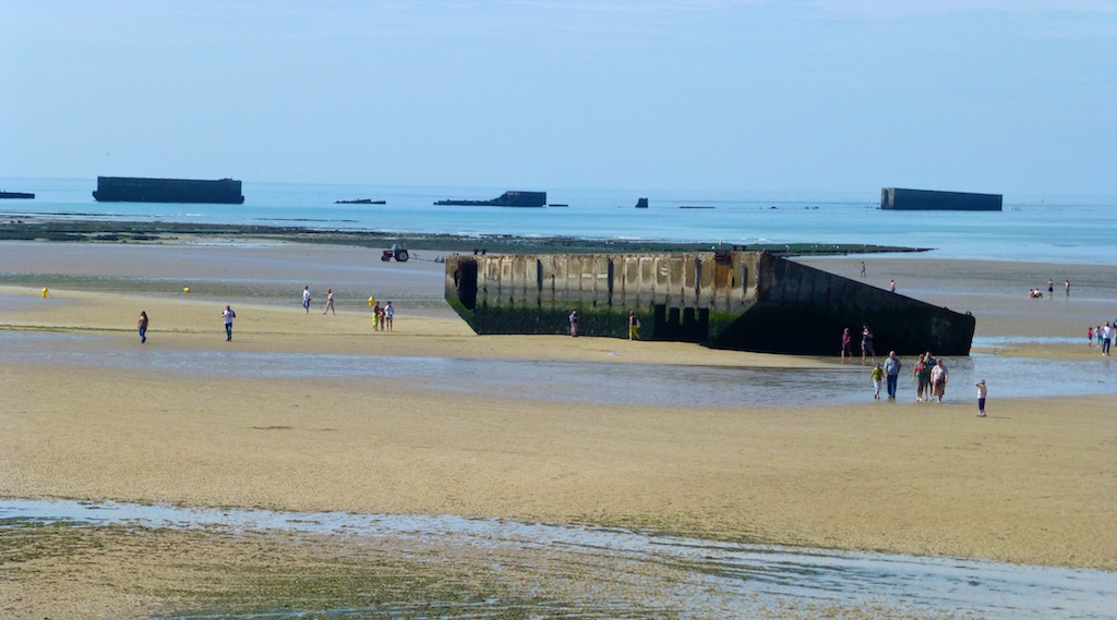 The ruins of World War II Mulberry Harbour at Arromanches, Normandy