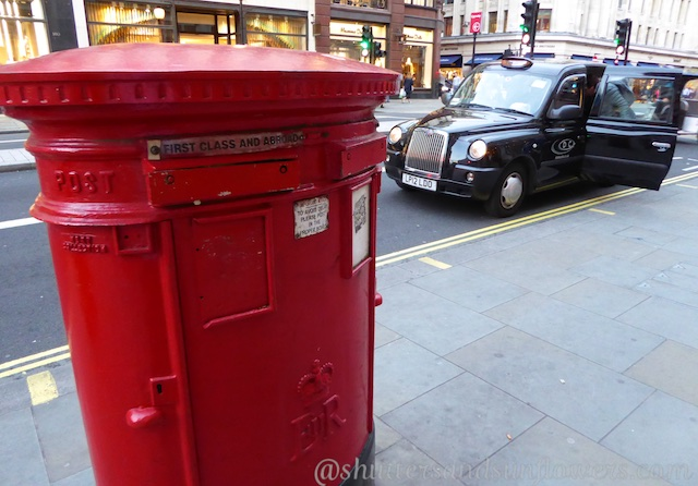 Red London letter boxes and black London taxis