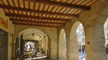 Arches of Place aux Herbes in Uzes