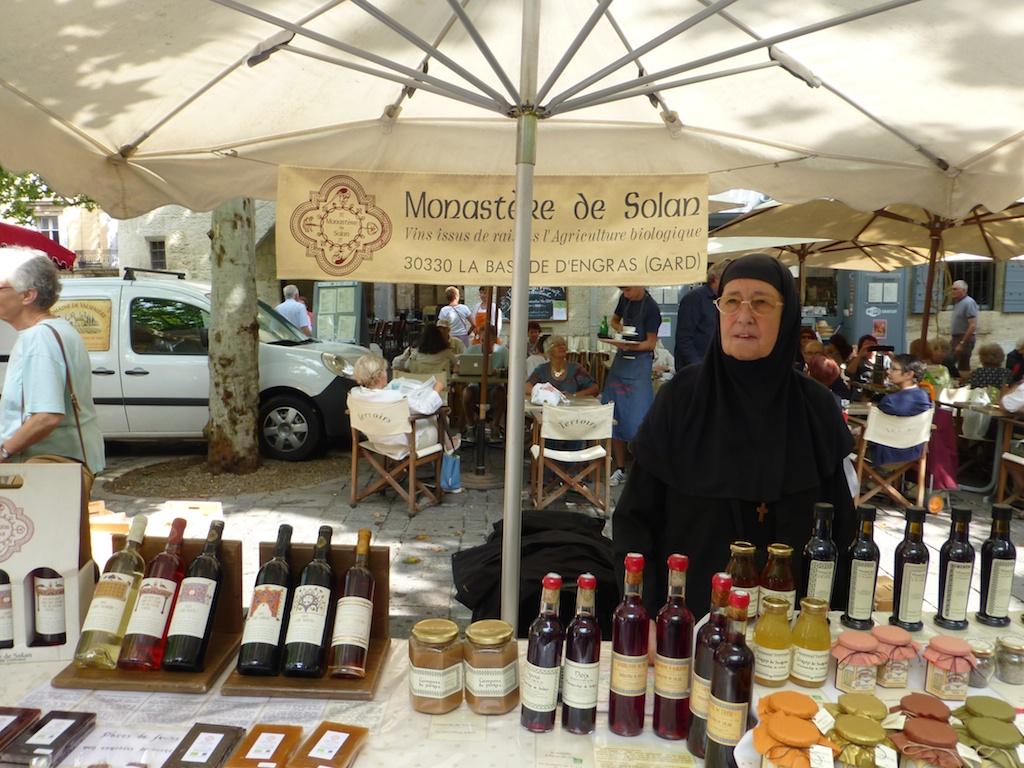 Nuns selling wine in the Uzes market, Languedoc Roussillon, France
