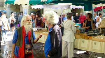 Speaking French at Wednesday Market in Uzes