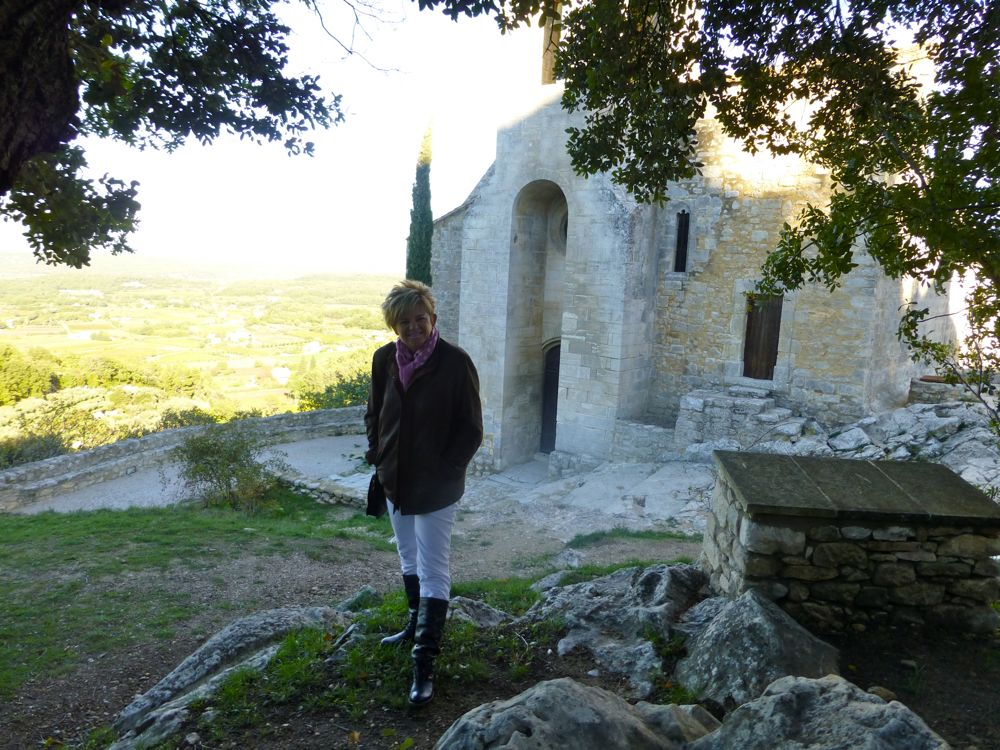 By foot of castle ruins ar the church, Oppede les Vieux, France