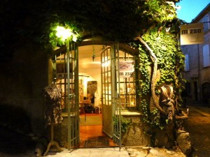 Inviting boutiques at dusk, in early November, Lourmarin, Provence, France