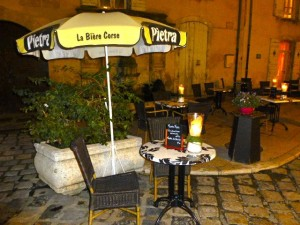 Cafes set for dinner at dusk, in early November, Lourmarin, Luberon, Provence, France