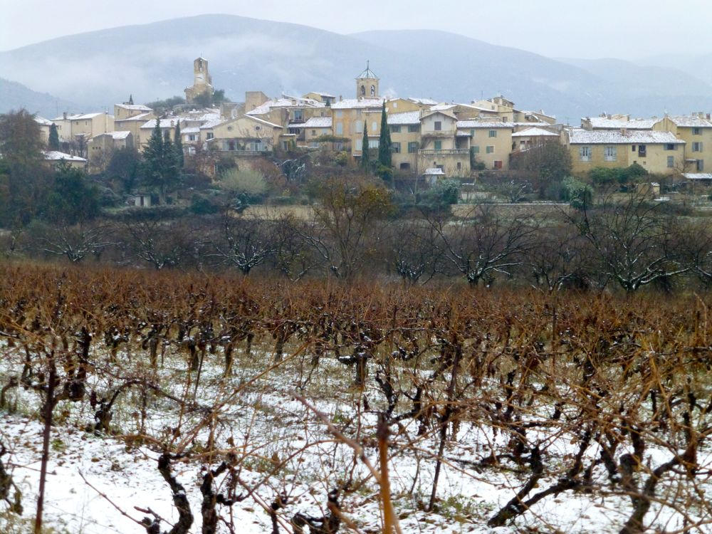 The view of Lourmarin, Provence, France in December snow