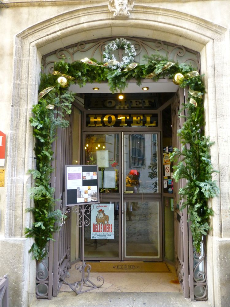 Restaurant doorway garlanded for Christmas in Avignon, Provence, France