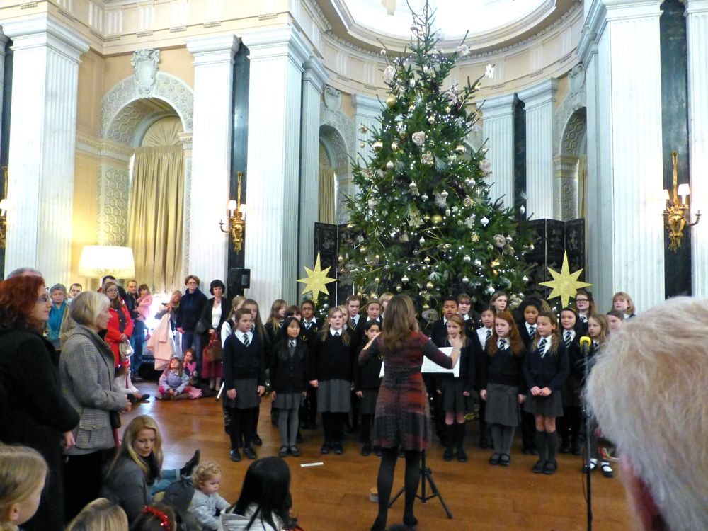 Children singing Christmas carols in the ballroom at Blenheim Palace, Woodstock, England