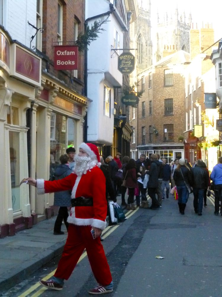 Santa on the streets in York, England, Christmas 2012