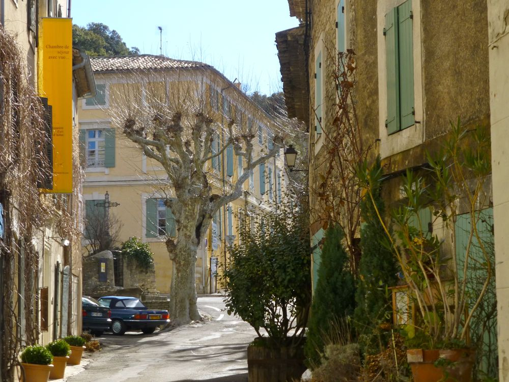 Provencal street with shuttered buidlings