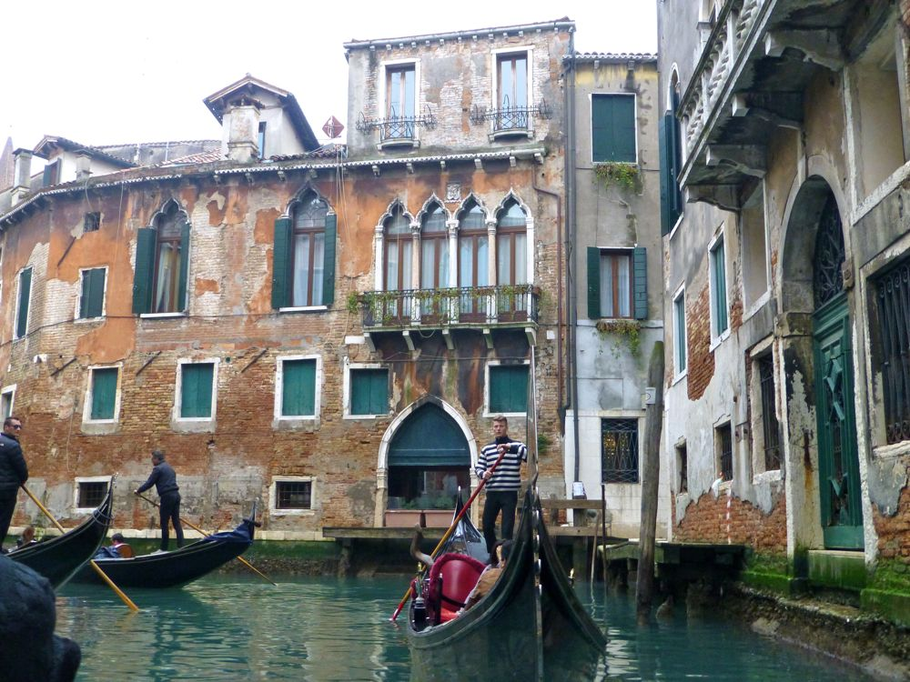 Decaying buildings seen from the gondola in Venice, Italy