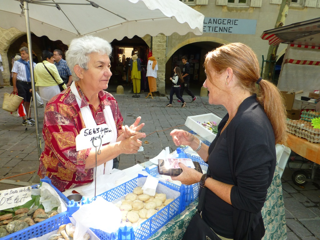 Goats cheese seller at Wednesday Market, Uzes, Languedoc Rousiilon, France