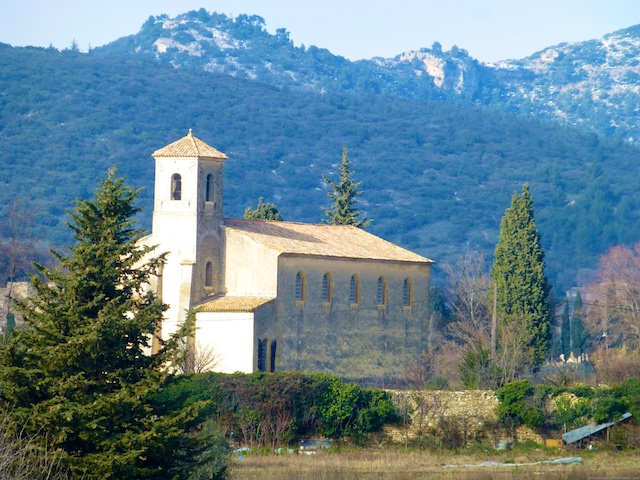 The church in Lourmarin against the Luberon Hills