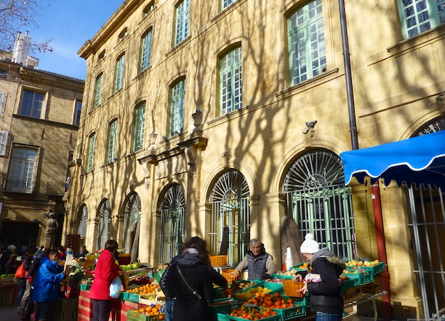 Market stalls by the Stately buildings of Aix-en-Provence