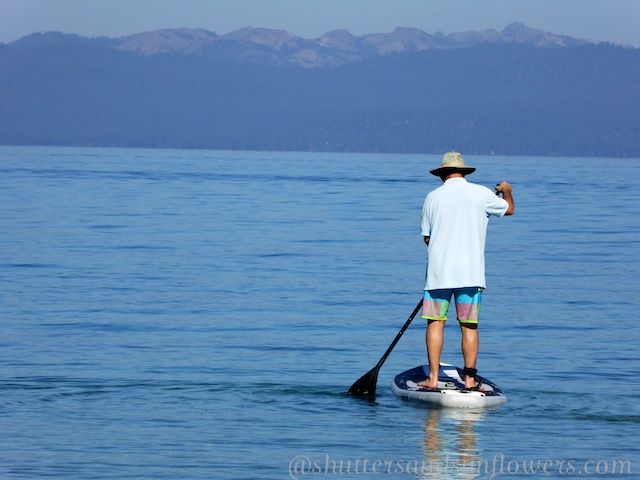 Paddling boarding from the Clear waters at the The East Shore of Lake Tahoe, California