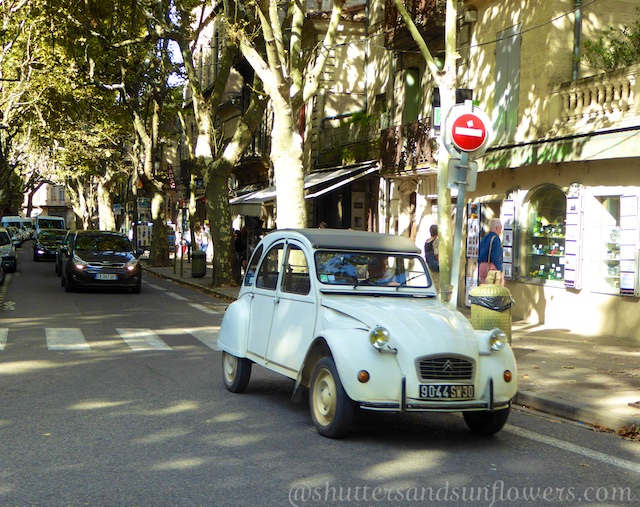 2CV on a street in Uzes, Languedoc Roussillon, France