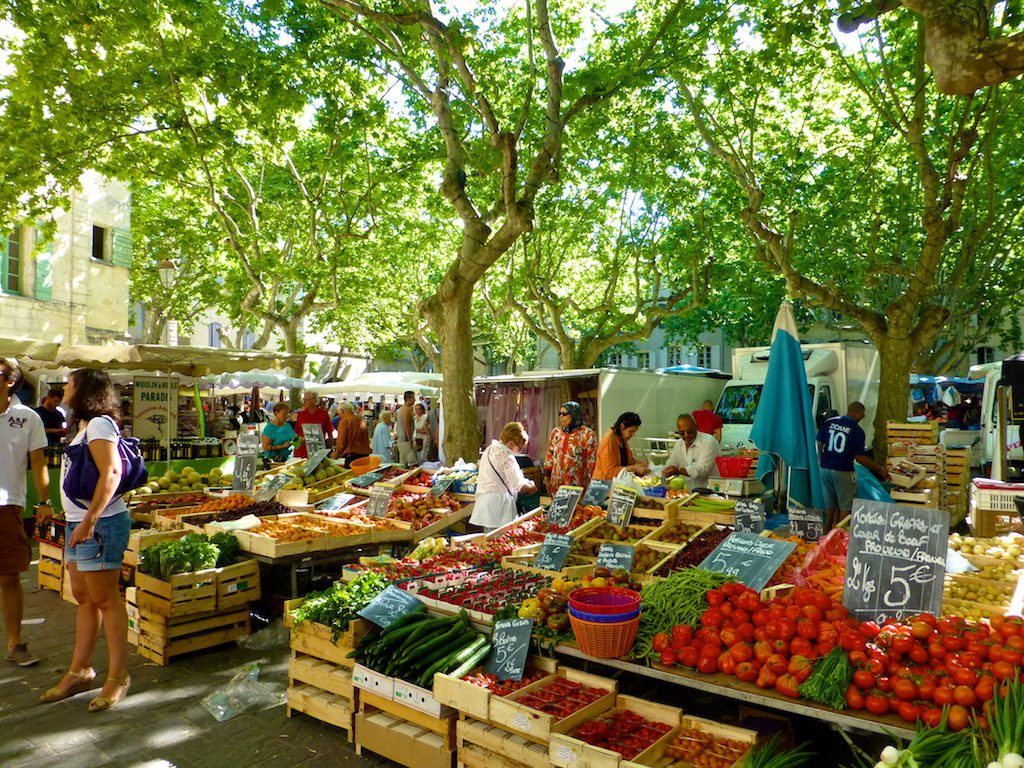 Plan your stay in Lourmarin visit the Uzes Market, Place aux Herbes, Uzes, Languedoc Roussillon, France