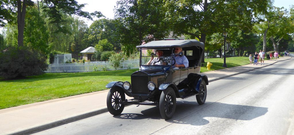 Model T Ford driving round Greenfield Village