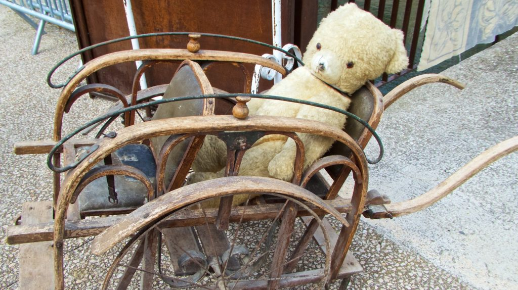French Victorian push-chair for sale in Sunday Antiques market at L'IIse-sur-la-Sorgue, Luberon, Vaucluse, provence, France
