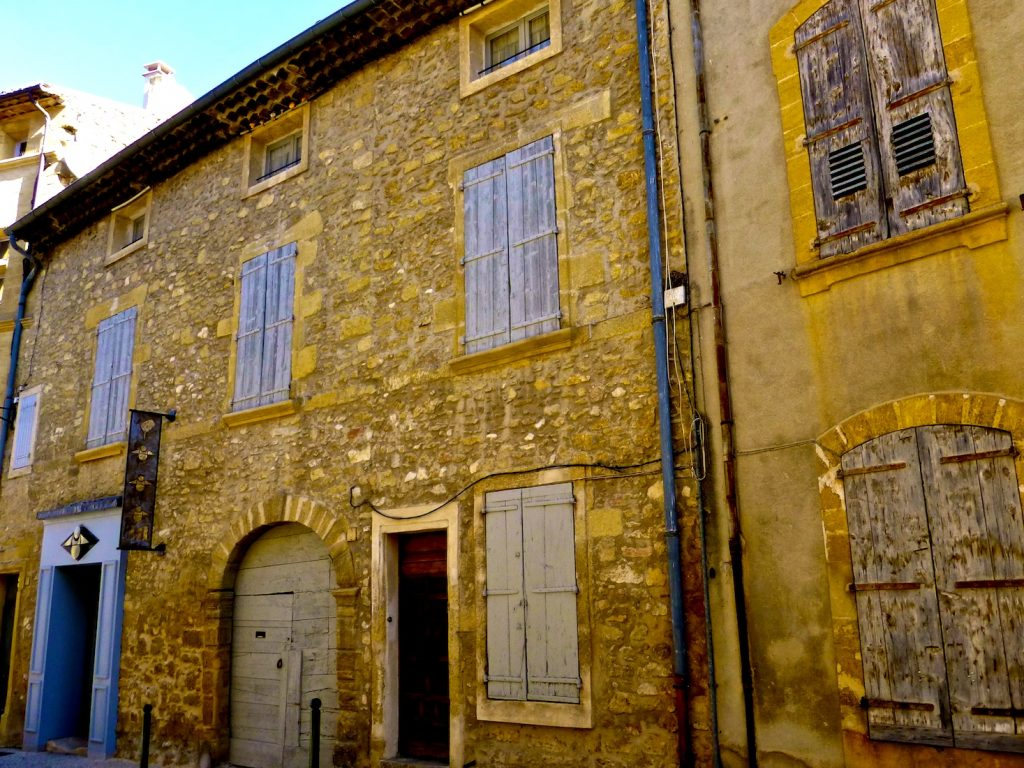 Shutters of Provence on medieval buildings in Lourmarin, Luberon, Provence, France