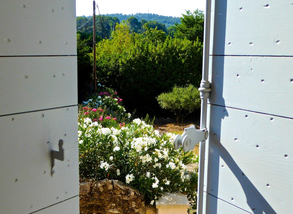 Open shutters of Provence in Lourmarin