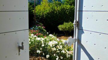 Open shutters of Provence in Lourmarin