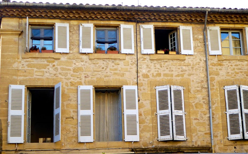 Shutters of Provence above a cafe in Lourmarin Provence, France