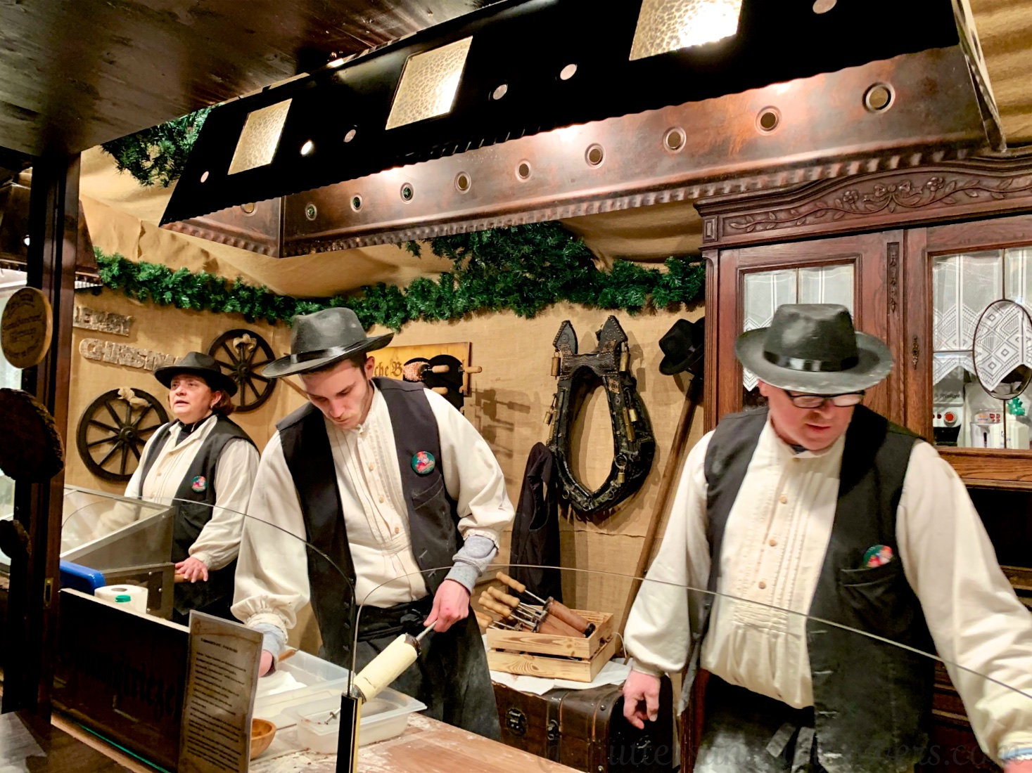 Strudel bakers dressed in traditional dress at the Cologne Christmas market