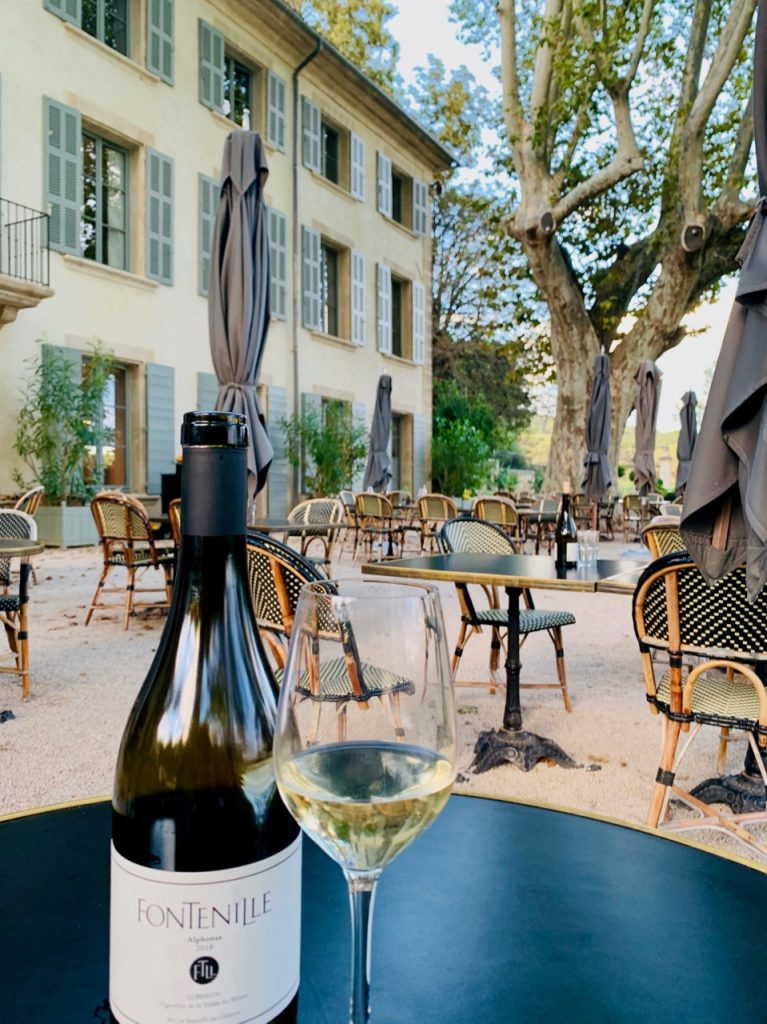 Wine on the terrace at Domaine de Fontinelle, Lauris, Luberon, Vaucluse, Provence, France