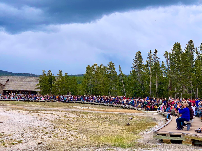 Crowds watching Old Faithful Geyser, Yellowstone National Park, USA